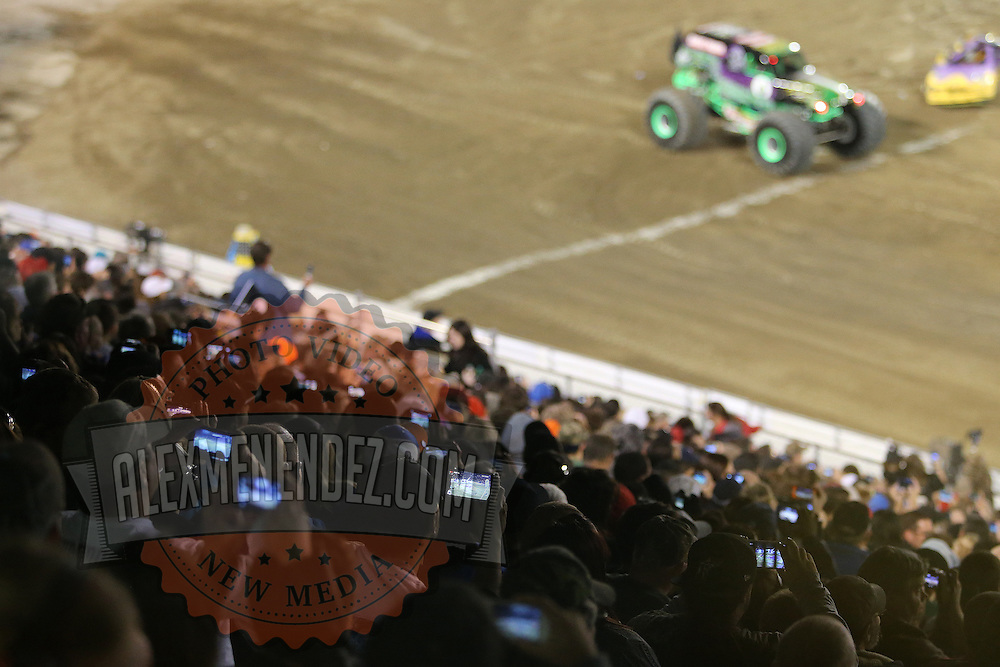 Fans hold up cell phones to capture a picture of Grave Digger, driven by Dennis Anderson during the Monster Jam big truck event at the Citrus Bowl in Orlando, Florida on Saturday, January 25, 2014. (AP Photo/Alex Menendez)