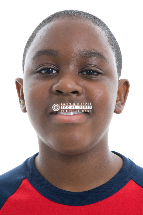 Portrait of a teenage boy smiling in the studio,