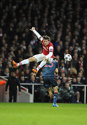 Arsenal's Nacho Monreal battles for the high ball with Bayern Munich's Thomas Muller - Photo mandatory by-line: Joe Meredith/JMP - Tel: Mobile: 07966 386802 19/02/2014 - SPORT - FOOTBALL - London - Emirates Stadium - Arsenal v Bayern Munich - Champions League - Last 16 - First Leg