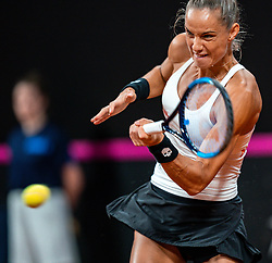 Arantxa Rus in action in the match against Aryna Sabalenka in the Fed Cup qualifier against Belarus in Sportcampus Zuiderpark, The Hague, Netherlands