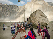 Girls playing volleyball. During the yearly celebration of Imamat Day (11 July), a day to celebrate the crowning of the current Aga Khan. Ismailis usually celebrate this day with dancing and religious singing, sport activities etc. In Passu village, upper Hunza, Gojal region.