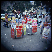 Men sell children's clothes in downtown Kabul.