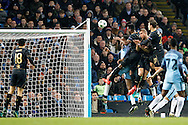 Celtic's Moussa Dembele (10) gets up to head on goal during the Champions League match between Manchester City and Celtic at the Etihad Stadium, Manchester, England on 6 December 2016. Photo by Craig Galloway.