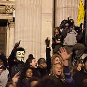 Protestors inside the police cordon are calling for letting people outside the cordon in. The London Stock Exchange was attempted occypied in solidarity with Occupy Wall in Street in New York and in protest againts the economic climate, blamed by many on the banks. Police managed to keep people away fro the Patornoster Sqaure and the Stcok Exchange and thousands of protestors stayid in St. Paul's Square, outside St Paul's Cathedral. Many camped getting ready to spend the night in the square.