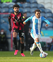 Huddersfield Town's Duane Holmes in action with  Bournemouth's Philip Billing<br /> <br /> Photographer Mick Walker/CameraSport<br /> <br /> The EFL Sky Bet Championship - Huddersfield Town v Bournemouth - Tuesday 13 April 2021 - The John Smith's Stadium - Huddersfield<br /> <br /> World Copyright © 2020 CameraSport. All rights reserved. 43 Linden Ave. Countesthorpe. Leicester. England. LE8 5PG - Tel: +44 (0) 116 277 4147 - admin@camerasport.com - www.camerasport.com