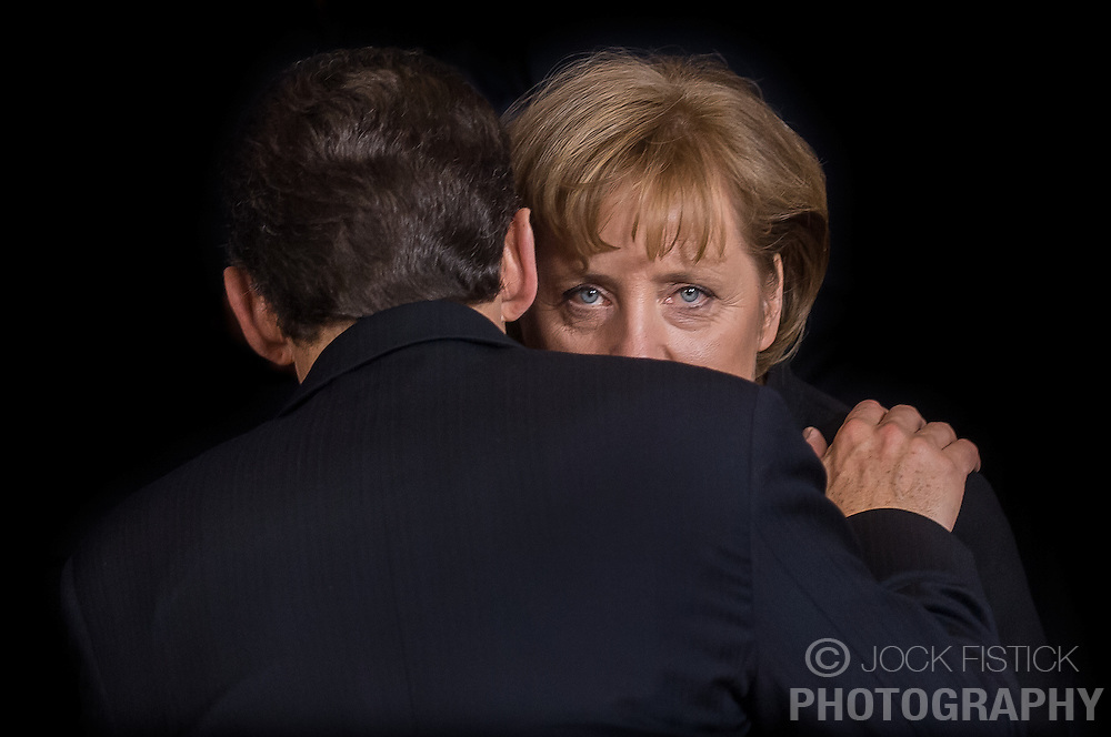 EURO CRISIS - German Chancellor Angela Merkel, listens to French President Nicolas Sarkozy, during the European Summit, in Brussels, Belgium. Merkel and Sarkozy were key players in finding a solution to the European financial crisis that saw Greece, Ireland, Spain, Italy and Portugal all seek economic bailout packages from the EU, ECB and IMF. (Photo © Jock Fistick)