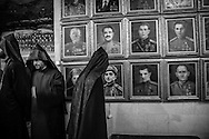 Armenian priests and the portraits of Armenian heroes of World War II at The Mother Armenia Museum. Yerevan. 2007.