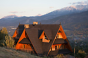 An aerial landscape of new housing in the Polish town of Koscielisko that is overlooked by the Tatra mountains, on 16th September 2019, near Zakopane, Malopolska, Poland. Local wealth has encouraged tourism apartments and short-stay properties in the Zakopane and Tatra National Park region, a very popular outdoor activity destination for city-dwelling Poles but at the cost of the local environment and landscape.