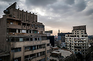 Cairo, Egypt - February 3, 2011: View from a rooftop on Mahmoud Bassiouny, a street beside Talaat Harb Square, looking toward the Egyptian Museum (pink dome) and Zamalek Tower in Cairo.