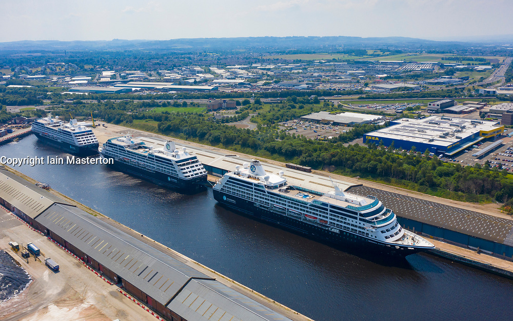 Glasgow, Scotland, UK. 25 June, 2020. Aerial view of the cruise ships Azamara Journey (nearest) and sister vessels, Azamara Quest (middle) and the Azamara Pursuit at King George V Docks on the Clyde in Glasgow. The ships are currently out of service due to the suspension of the cruise industry because of Covid-19 pandemic.  Iain Masterton/Alamy Live News