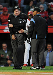 April 19, 2018 - Anaheim, CA, U.S. - ANAHEIM, CA - APRIL 19: Home plate umpire Jerry Layne (24) grimmices after being hit in the right arm by a foul ball hit by Los Angeles Angels Mike Trout (27) in the first inning of a game against the Boston Red Sox played on April 19, 2018 at Angel Stadium of Anaheim in Anaheim, CA. Layne would leave the game in the first inning. (Photo by John Cordes/Icon Sportswire) (Credit Image: © John Cordes/Icon SMI via ZUMA Press)