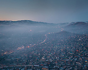 Air pollution in the Dari Ekh Ger district. One of the main reason for air pollution is the unplanned rapid urbanization of Mongolia's capital. It results in uncontrolled coal burning, used for cooking and heating.<br />