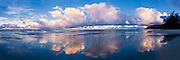 Panorama of sunset cloud formations reflecting on the wet beach at Punaluu on the windward coast of Oahu, HI