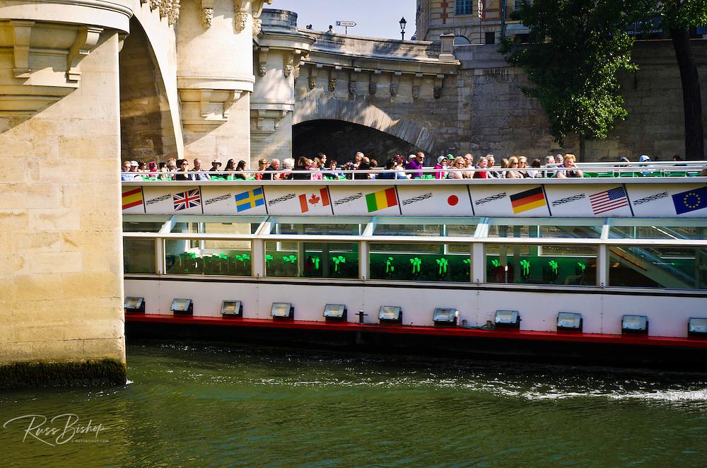 Tour boat passing under Pont Neuf (the New Bridge) Paris, France