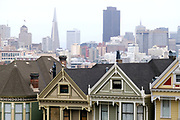 Famous Victorian Houses and Skyline viewed from Alamo Square, San Francisco, California, USA