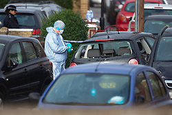 Forensics investigators examine a VW Polo with its windows smashed and a Vauxhall Zfafira with damage to its front left corner,  thought by police to be connected to Sunday evening's quadruple stabbing on Fraser Road, Edmonton in North London and possibly to be linked to a shooting on Gordon Road on Saturday 17th November. Edmonton, London, November 19 2018.
