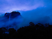 Angel Falls waterfall, the tallest in the world at 979m, falls from Auyantepui mountain at dusk in Canaima National Park, Venezuela