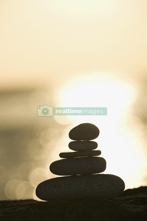 Jun. 20, 2009 - A stone stack against a setting sun. Not Released (NR) (Credit Image: © Cultura/ZUMAPRESS.com)