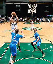March 20, 2017 - Reno, Nevada, U.S - Reno Bighorn Guard LUIS MONTERO (2) shoots in the paint against Texas Legends Guard KYLE COLLINSWORTH (6) and Texas Legends Guard KEITH HORNSBY (4) during the NBA D-League Basketball game between the Reno Bighorns and the Texas Legends at the Reno Events Center in Reno, Nevada. (Credit Image: © Jeff Mulvihill via ZUMA Wire)