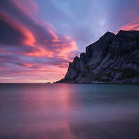 Colorful sunrise over mountains at Bunes Beach, Moskenesoy, Lofoten Islands, Norway