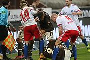 Fussball: 2. Bundesliga, FC St. Pauli - Hamburger SV, Hamburg, 01.03.2021<br /> Disput: Sonny Kittel (HSV), Guido Burgstaller (Pauli, am Boden) und Rock van Drongelen (HSV)<br /> © Torsten Helmke