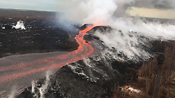 July 3, 2018 - Hawaii, U.S. - Fissure 8 and the upper lava channel, viewed from the early morning helicopter overflight of the lower East Rift Zone. Recent heavy rains have soaked into the still-warm tephra and the moisture rises as steam (right side of lava channel). (Credit Image: © USGS/ZUMA Wire/ZUMAPRESS.com)
