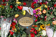 Fans paid their respects to B.B. King outside of this Memphis Blues Club by laying flowers on the musical note dedicated to him on Beale Street in Memphis, Tennessee on Saturday. B.B. was a nick name given to him on Beale Street.  His nick name was Beale Street Blues Boy. The Mississippi-born legend died in his sleep at 11:40 p.m on Thursday night. King made a name for himself as a young man, as a blues artist on Beale Street in Memphis, where he later opened a name sake club. (© Photo by Karen Pulfer Focht)
