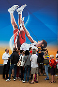 London 2012 Olympic Park in Stratford, East London. Crowds of people queue to get into the London 2012 Megastore to go shopping for related merchandise. Olympic stars, like this POlish pole vaulter adorn the building in large scale illustrations.