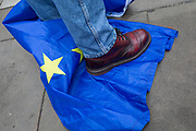 A Brexiteer's boots read on the EU flag on Brexit Day, the day when the UK legally leaves the European Union, in Westminster, on 31st January 2020, in London, England.