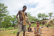 A Hadza male playing a rebab a single-string bowed lute.The Hadza, or Hadzabe, are an ethnic group in north-central tanzania, living around Lake Eyasi in the Central Rift Valley and in the neighboring Serengeti Plateau.