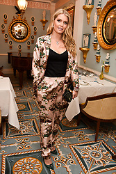 Lady Kitty Spencer at an afternoon tea in honour of Megan Hess hosted by Lady Violet Manners at The Lanesborough, Hyde Park Corner, London, England. 10 November 2017.