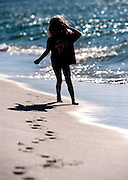 A 4-year-girl plays on the beach in Fort Morgan, Alabama.