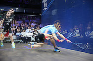 a multiple exposure image as Omar Mosaad of Egypt (wearing light Blue shirt) hits a shot against Mathieu Castagnet of France (wearing Black shirt). the Final, Omar Mosaad of Egypt v Mathieu Castagnet of France , Canary Wharf Squash Classic 2016 , at the East Wintergarden in Canary Wharf , London on Friday 11th March 2016.<br /> pic by John Patrick Fletcher, Andrew Orchard sports photography.