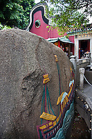 400 year old carving of a sail boat on a rock at the A-Ma Temple in Macau.