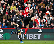 John Egan of Sheffield Utd and Teemu Pukki of Norwich City during the Premier League match at Bramall Lane, Sheffield. Picture date: 7th March 2020. Picture credit should read: Simon Bellis/Sportimage