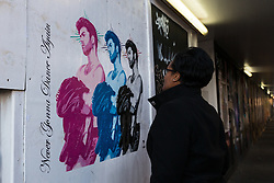 "© Licensed to London News Pictures. 29/12/2016. LONDON, UK.  A woman looks at a new George Michael street art by Pegasus in Shoreditch, east London. The artwork shows three Faith-era images of the singer, who was found dead in his bed on Christmas Day, with a quote from anthem Careless Whisper, saying: ""Never Gonna Dance Again"".  US born street artist Pegasus, who became well known after his image of Meghan Markle created the new artwork in London yesterday, saying that he wanted to pay tribute to George Michael because of the inspiration he had been given by him. Photo credit: Vickie Flores/LNP"
