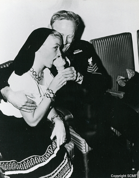 1944 Veronica Lake eats an ice cream cone at the Hollywood Canteen