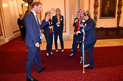 Prince Harry meets the ladies Hockey Team with Susannah Townsend on crutches during a reception for Team GB and ParalympicsGB medallists from the 2016 Olympic and Paralympic Games at Buckingham Palace in London.
