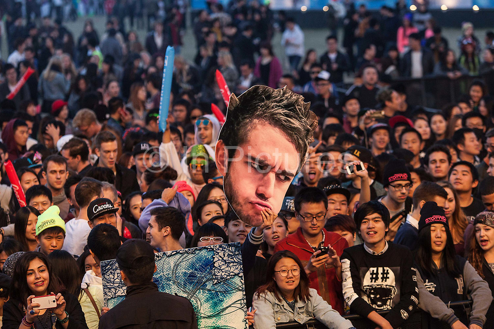 Chinese youths attend the Storm Music Festival, a gathering of big names in electronic music  in Shanghai, China on 12 December 2013.