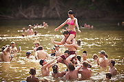 People take a break from the heat in the Oconee River during the annual Summer Redneck Games Dublin, GA.