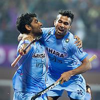 BHUBANESWAR  (INDIA) -  Quater Finals Belgium vs India of the Hero Champions Trophy Hockey.  Uthappa Sannuvanda  (l)  of India has scored 2-2.  right Chandanda Thimmaiah of India. Photo KOEN SUYK