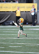 A young fan wears team apparel as he runs onto the field before the Green Bay Packers 2016 NFL Pro Football Hall of Fame preseason football game against the Indianapolis Colts on Sunday, Aug. 7, 2016 in Canton, Ohio. The game was canceled for player safety reasons due to the condition of the paint on the turf field. (©Paul Anthony Spinelli)