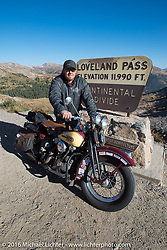 After his HD VL suffered a catastrophic failure, Jason Sims rides a 1939 Harley-Davidson Knucklehead from Carl's Cycles at the top of Loveland Pass during Stage 10 (278 miles) of the Motorcycle Cannonball Cross-Country Endurance Run, which on this day ran from Golden to Grand Junction, CO., USA. Monday, September 15, 2014.  Photography ©2014 Michael Lichter.