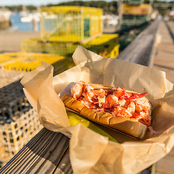 A lobster roll on the dock behind Luke's Restaurant on Miller's Wharf in Tenants Harbor, Maine.