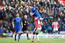 Everton's Michael Keane (top) and Stoke City's Saido Berahino battle for a header