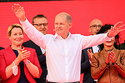 SPD Chancellor candidate and current German Finance Minister Olaf Scholz waves to the crowd during an election campaign event of the German Social Democratic Party (SPD) at Bebelplatz square In Berlin, Germany, August 27, 2021. Germany's federal elections are due to take place on September 26, 2021.
