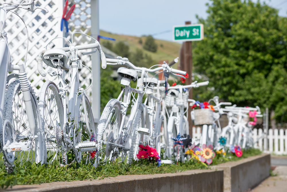 Fence made with old bicycles in front of a house in Prairie City, Oregon.