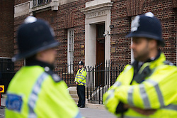 © London News Pictures. 02/05/2015. Police stand outside the hospital before Catherine Duchess of Cambridge and Prince William leave the Lindo Wing of St Mary's hospital in London holding their new born baby daughter, Princess of Cambridge. Photo credit: Ben Cawthra /LNP