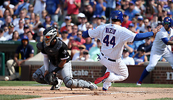 July 25, 2017 - Chicago, IL, USA - The Chicago Cubs' Anthony Rizzo (44) scores as Chicago White Sox catcher Omar Narvaez awaits the throw in the sixth inning on Tuesday, July 25, 2017, at Wrigley Field in Chicago. The Cubs won, 7-2. (Credit Image: © Brian Cassella/TNS via ZUMA Wire)