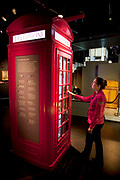Interactive red phone box exhibit. The Museum of London is one of the world's largest urban history museums and cares for over two million objects in its collection. The Museum holds the largest archaeological archive in Europe of this wealth of information. Each of the galleries is dedicated to a different era in London's history.